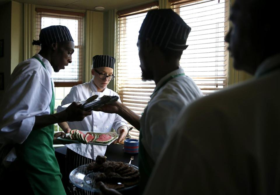 At SnapChef in Dorchester, the company's Meagan Greene worked with trainees.