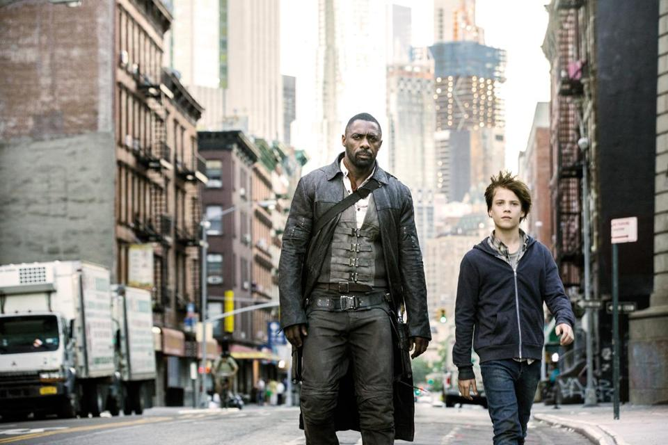 "Idris Elba (left) and Tom Taylor in ""The Dark Tower."""