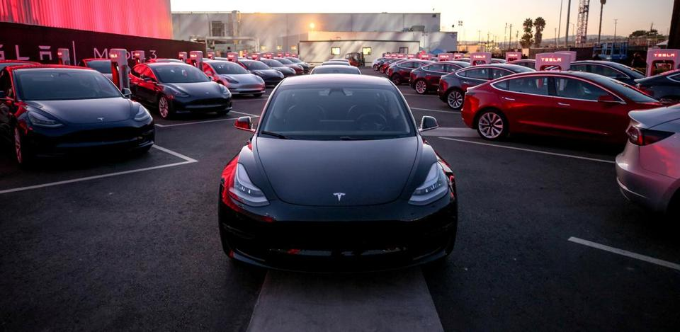 In an update handout photo, Tesla Model 3 cars during an event at the factory handing over its first 30 Model 3 vehicles to employee buyers. The electric-car maker Tesla reported on Aug. 2, 2017, that its losses widened in the second quarter as it continued to invest in factories to accommodate the introduction of its first mass-market vehicle. (Tesla via The New York Times) -- NO SALES; FOR EDITORIAL USE ONLY WITH TESLA EARNINGS BY BILL VLASIC FOR AUG. 3 2017. ALL OTHER USE PROHIBITED. --