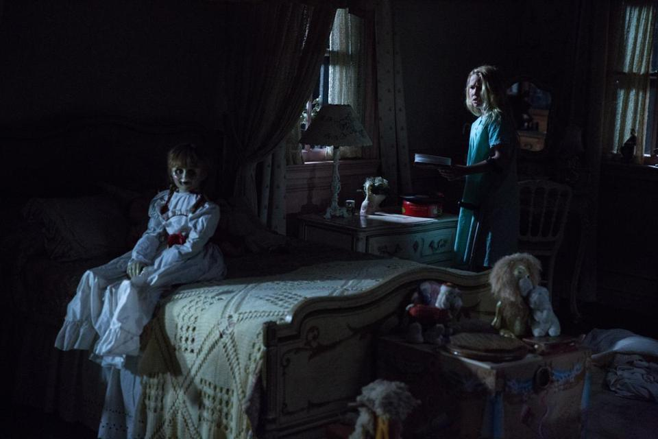Talitha Bateman (right) in a scene with Annabelle, the demonically possessed doll.