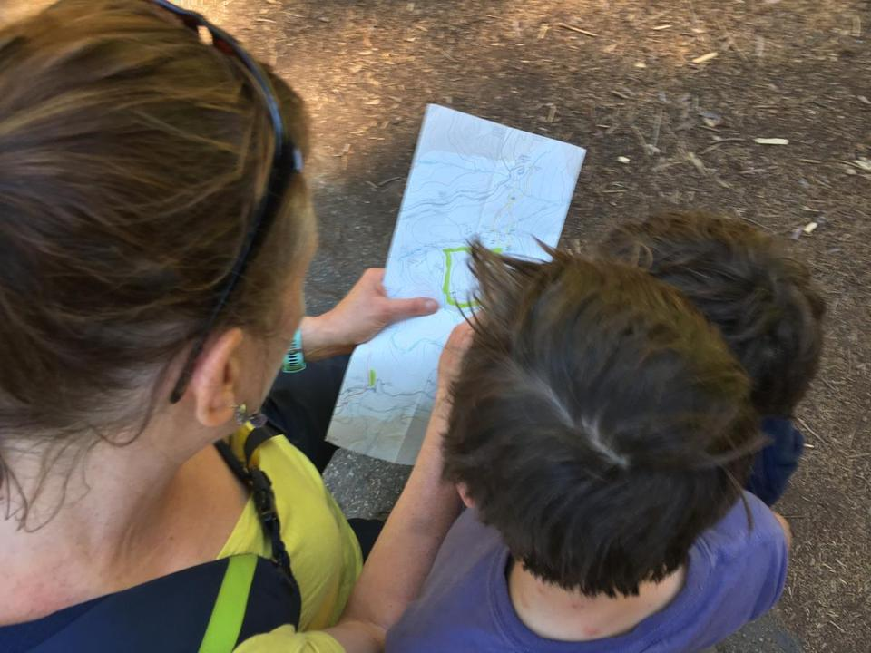 The author and her two sons consult a map while on vacation in California.
