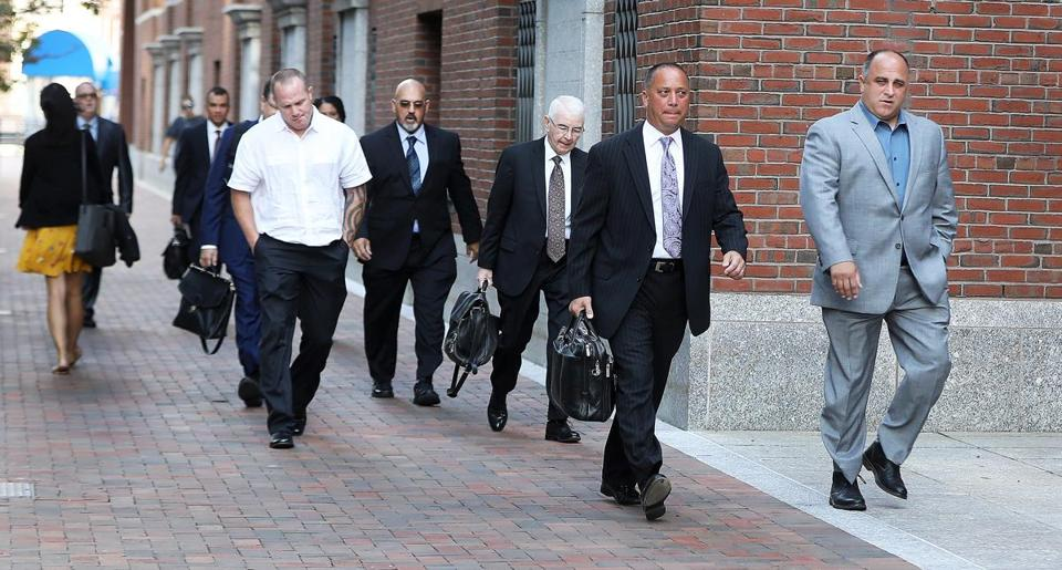 Defendants and attorneys arrived at the John Joseph Moakley United States Courthouse on Monday.