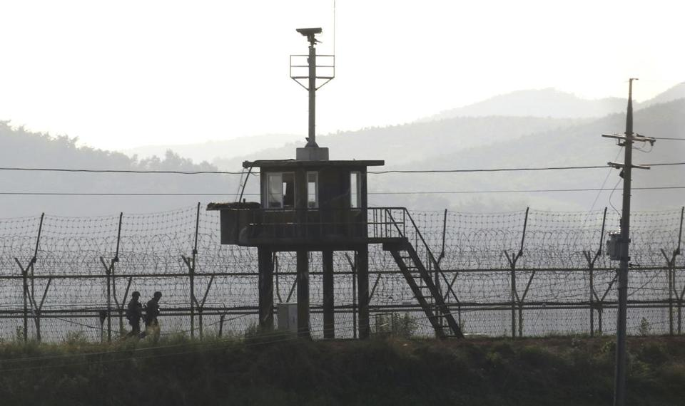 South Korean soldiers patrolled along the barbed-wire fence in Paju, near the border with North Korea, on Monday.