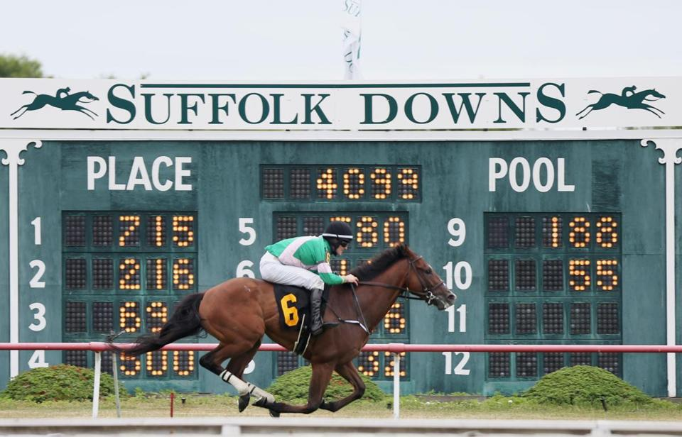 BOSTON, MA - 7/9/2016: Jockey Kieran Norris (cq) and horse Reporter (cq) win Saturday's first race at Suffolk Downs in East Boston. It was the first of six days of racing at Suffolk Downs this year. (Timothy Tai for The Boston Globe)