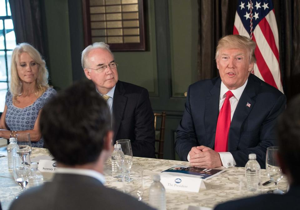 President Donald Trump spoke at a meeting with administration officials, including Counselor Kellyanne Conway (left) and Health and Human Services Secretary Tom Price (center).