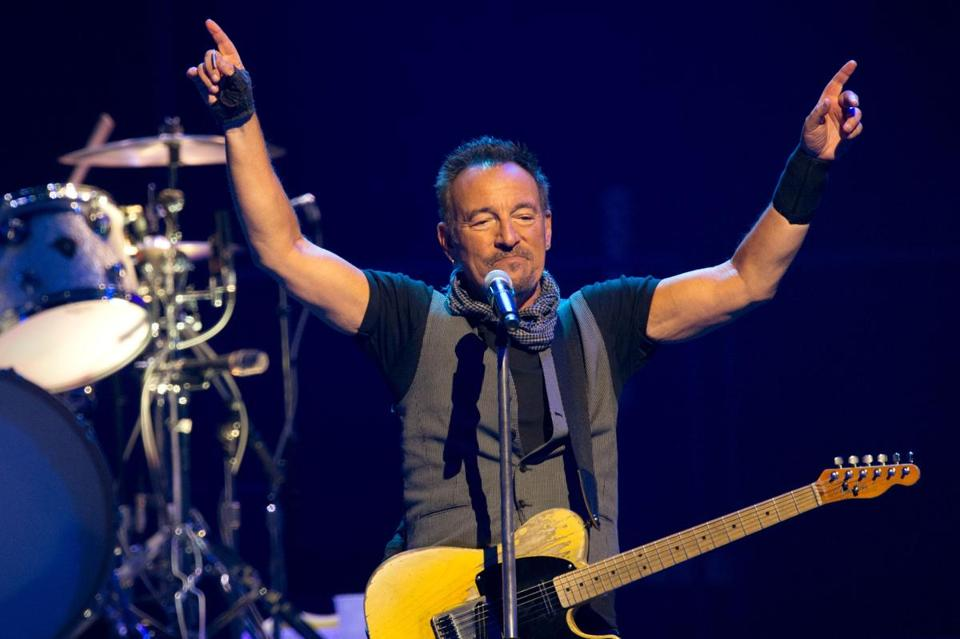 "(FILES) This file photo taken on July 11, 2016 shows US musician Bruce Springsteen with the E Street Band at the AccorHotels Arena in Paris. Bruce Springsteen, renowned for his high-energy marathon concerts to packed arenas, is dialing it down a notch and heading to Broadway.""The Boss"" announced on August 9, 2017 that he would play a series of solo shows on New York's famed theater strip beginning in October.""I wanted to do some shows that were as personal and as intimate as possible,"" the 67-year-old rock legend said in a statement. / AFP PHOTO / BERTRAND GUAYBERTRAND GUAY/AFP/Getty Images"