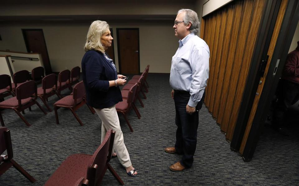 Representative David Young spoke with a Chamber of Commerce leader during a visit to Glenwood, Iowa.