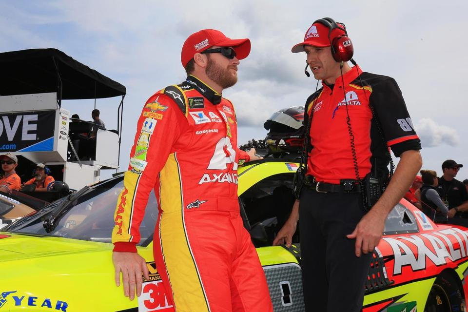 WATKINS GLEN, NY - AUGUST 06: Dale Earnhardt Jr., driver of the #88 Axalta Chevrolet, and crew chief Greg Ives talk during qualifying for the Monster Energy NASCAR Cup Series I Love NY 355 at The Glen at Watkins Glen International on August 6, 2017 in Watkins Glen, New York. (Photo by Chris Trotman/Getty Images)