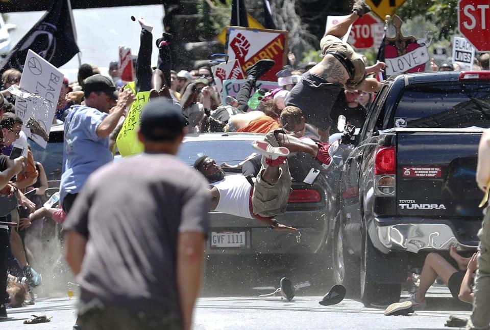 People flew into the air as a car drove into a group of protesters demonstrating against a white nationalist rally in Charlottesville on Saturday.
