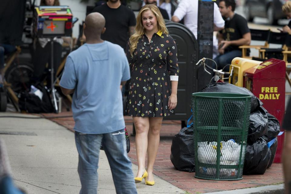"Amy Schumer talks with an extra on the set of ""I Feel Pretty,"" which she just finished filming in Boston."