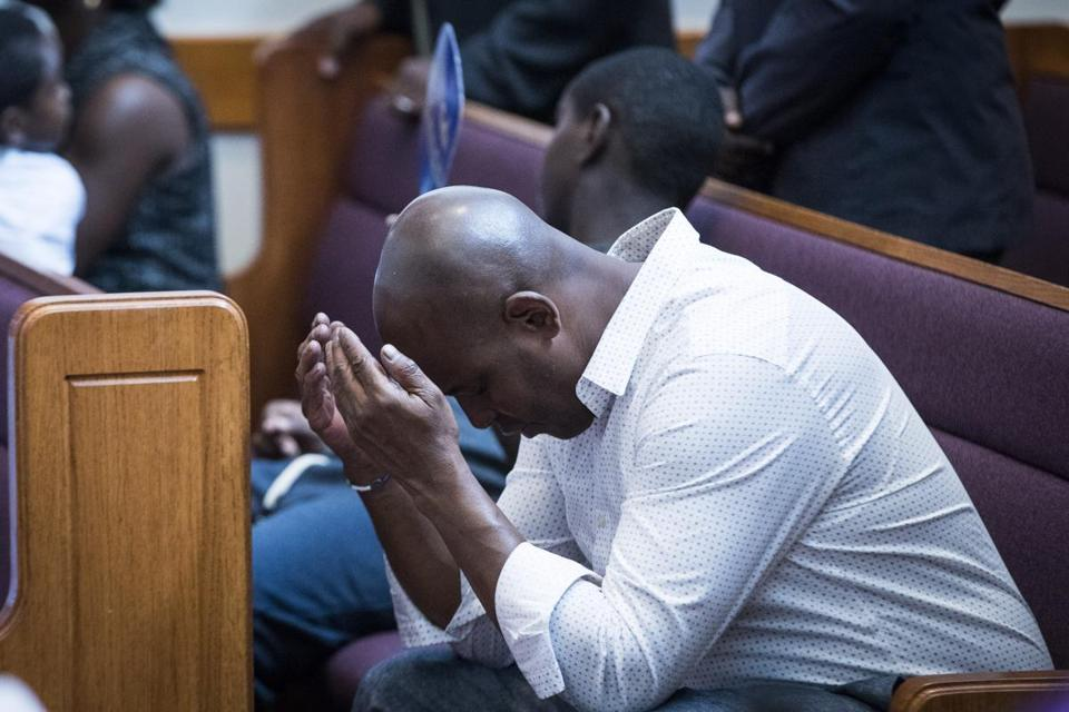 A congregant bowed his head during the bishop's prayer at Morning Star Baptist Church.