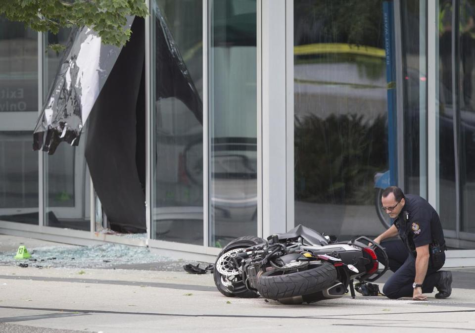 "A police officer examined a motorcycle after a female stunt driver working on the movie ""Deadpool 2"" died after a crash on set, in Vancouver, B.C., on Monday."