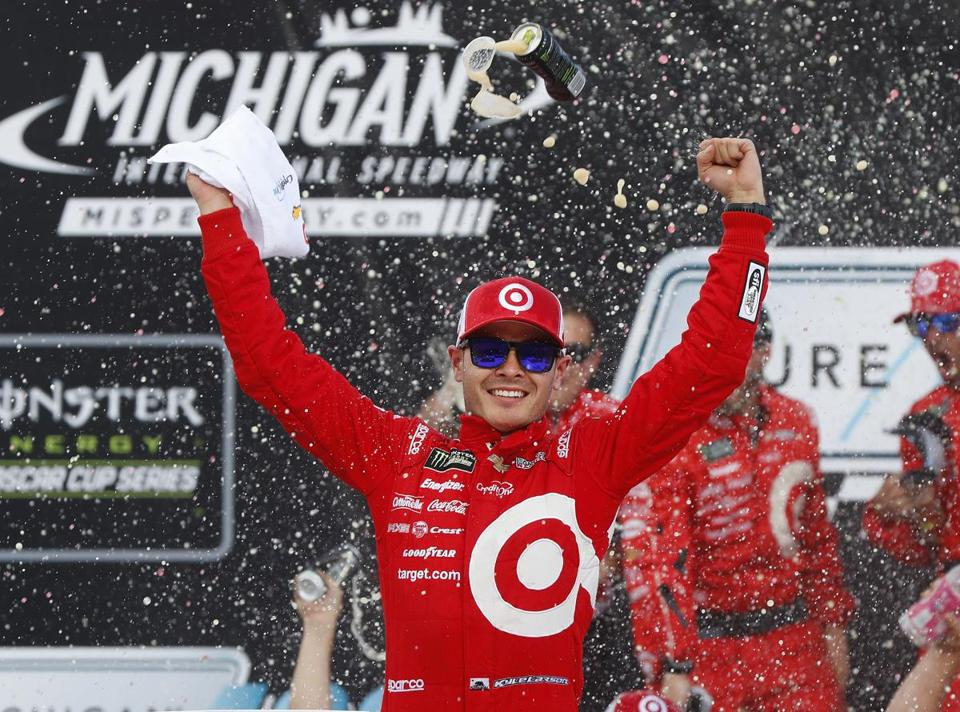 Kyle Larson celebrates winning the NASCAR Cup Series auto race in Brooklyn, Mich., Sunday, Aug. 13, 2017. (AP Photo/Paul Sancya)