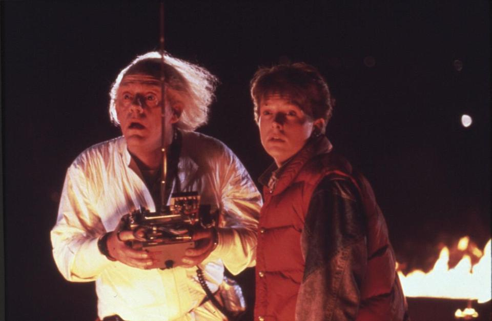 "MOVIES: Christopher Lloyd, left, as Dr. Emmett Brown and Michael J. Fox as Marty McFly in the 1985 film ""Back to the Future."" PHOTO CREDIT: Universal Pictures 02demand"