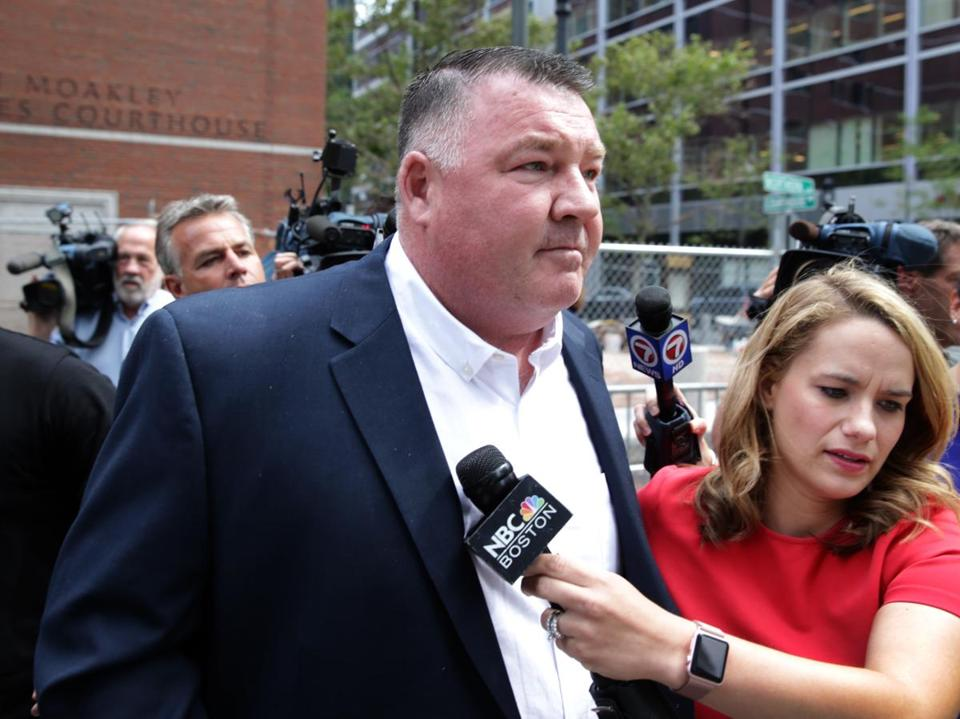 Defendant John Fidler departed the John Joseph Moakley Courthouse after being found not guilty.