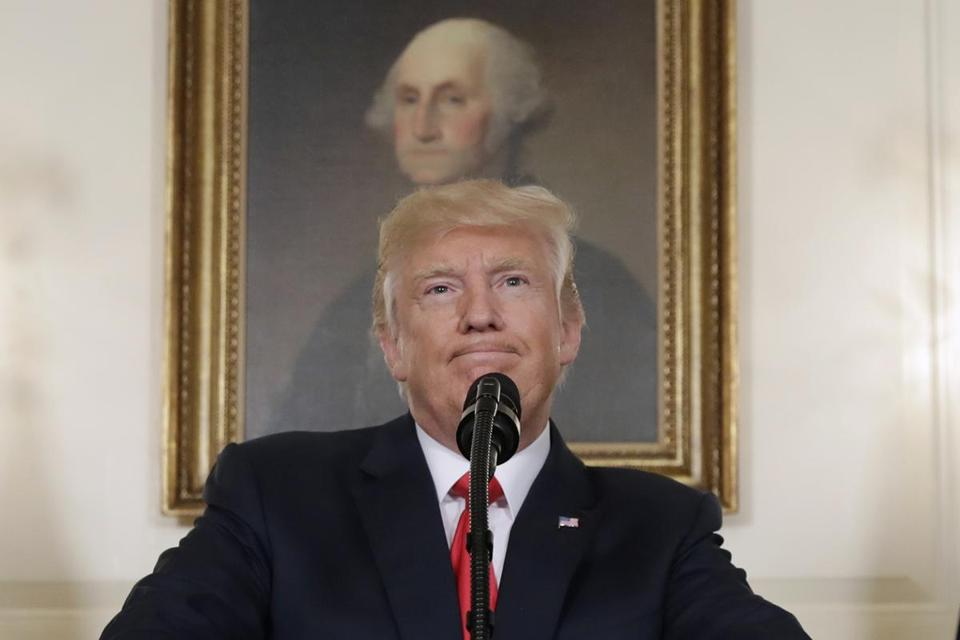 In this Aug. 14, 2017, photo, President Donald Trump pauses while speaking in the Diplomatic Reception Room of the White House in Washington. Is it really so far-fetched to put Robert E. Lee in the same category as George Washington, as President Donald Trump suggested Tuesday? Many historians say yes. (AP Photo/Evan Vucci, File)