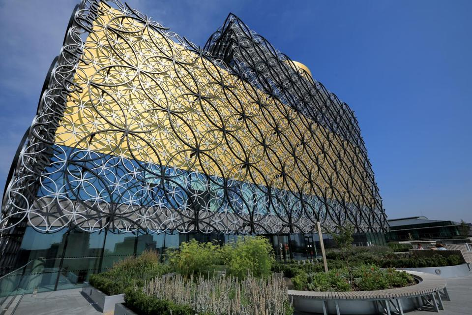 BIRMINGHAM, ENGLAND - AUGUST 27: An exterior view of the new Library of Birmingham and it's outdoor roof terrace garden at Centenary Square on August 27, 2013 in Birmingham, England. The new futuristic building designed by architect Francine Hoube officially opens on September 3 and has cost 189 million GBP. The modern exterior of interlacing rings reflects the canals and tunnels of Birmingham. The library's ten floors will house the city's internationally important collections of archives, photography and rare books as well as it's lending library. (Photo by Christopher Furlong/Getty Images)