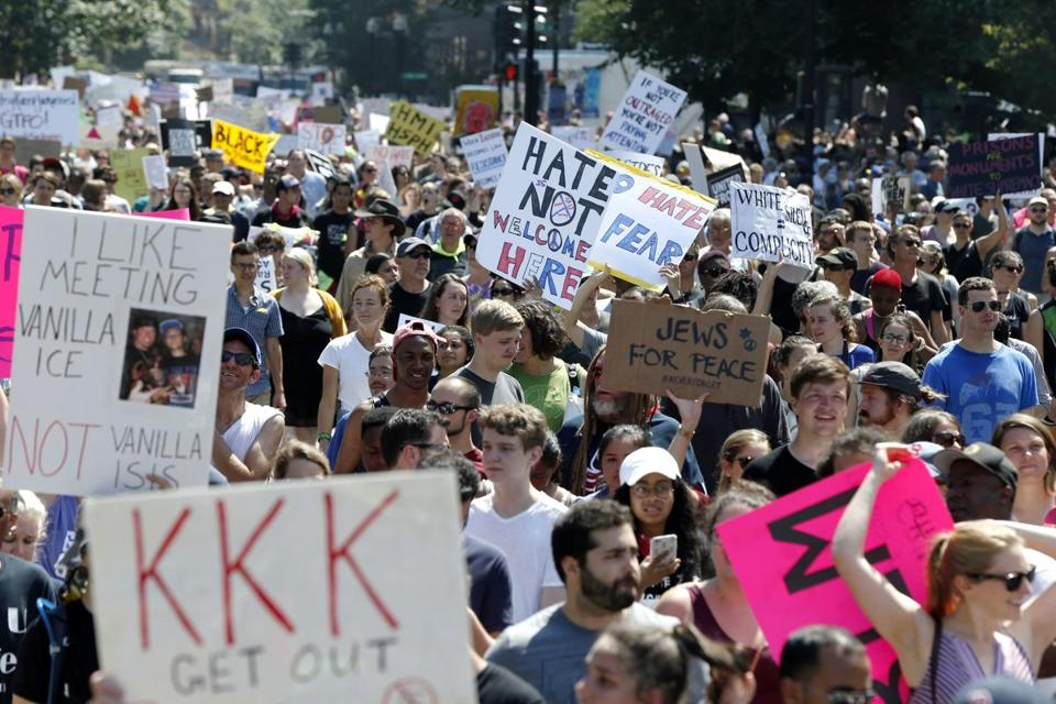 "Counterprotesters stand on the periphery of a ""Free Speech"" rally staged by conservative activists on Boston Common, Saturday, Aug. 19, 2017, in Boston. One of the planned speakers of a conservative activist rally that appeared to end shortly after it began says the event ""fell apart."" Dozens of rallygoers gathered Saturday on Boston Common, but then left less than an hour after the event was getting underway. Thousands of counterprotesters had also gathered. (AP Photo/Michael Dwyer)"