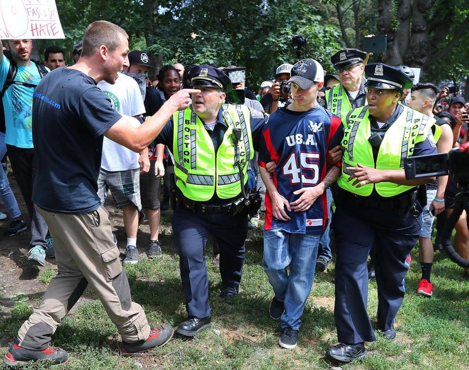 "A protester screamed at a ""free speech"" rally attendee who was escorted from Boston Common by police."