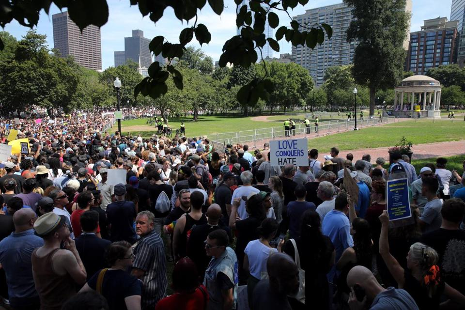 "Boston, MA- August 19, 2017: View of ""Boston Free Speech"" rally, right, and protest at the Boston Common, Boston, MA on August 19, 2017. Thousands of protesters are expected to flood downtown Boston Saturday, with the ""Boston Free Speech"" rally on Boston Common likely surrounded by several different counter-actions. (CRAIG F. WALKER/GLOBE STAFF) section: metro reporter:"