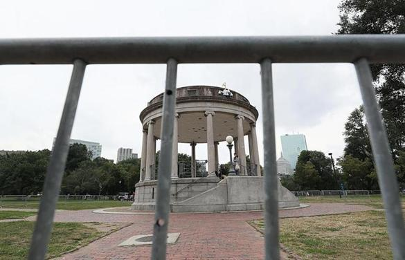 Barricades are set up surrounding the bandstand on the Boston Common in advance of the weekend rally.