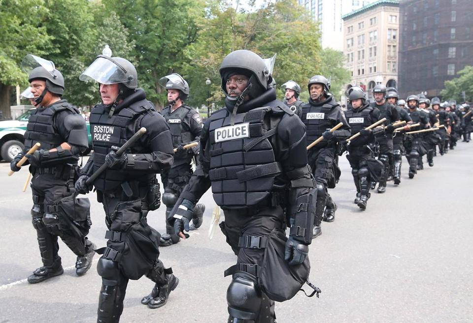 "Boston Ma 8/19/17 Armored police officers march down Beacon Street during the right-wing ""free speech"" demonstrators in the Boston Common and the counter rally. (Matthew J. Lee/Globe staff) topic: reporter:"