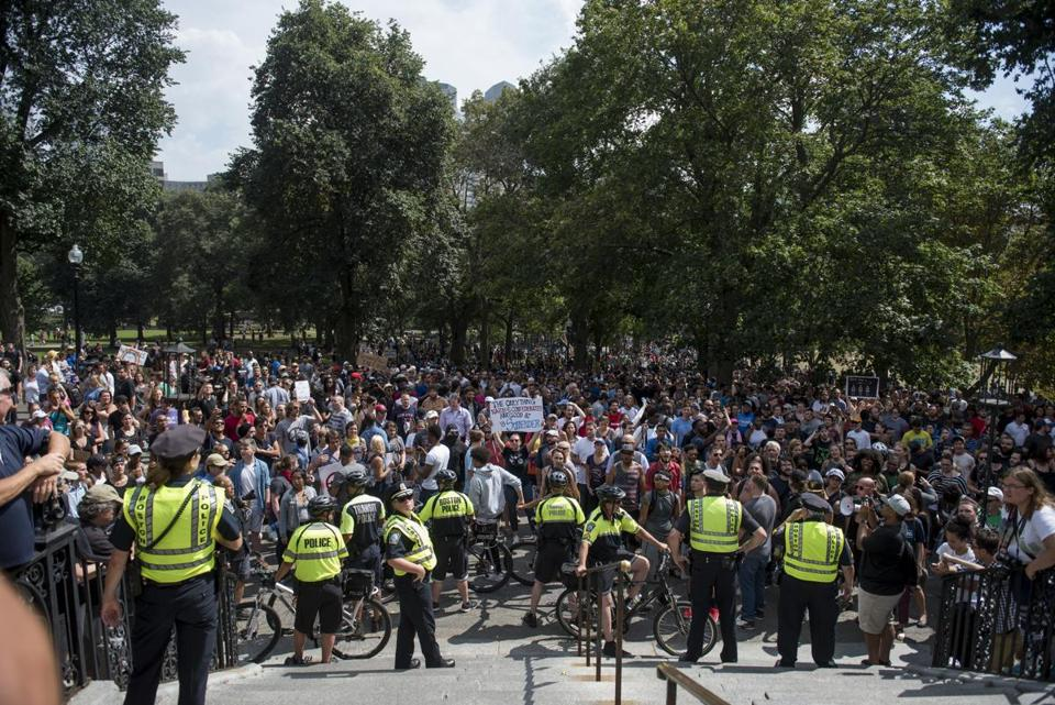 "Boston, MA - 8/19/17 - After pursuing an apparent ""free speech"" protester while he was escorted to a paddy wagon by police, a crowd forms on the outskirts of the Boston Common where free speech and other conservative groups sparked an enormous counter-protest on Saturday, August 19, 2017. This day's protest occurred as part of the ongoing national outrage after protests in Charlottesville, Virginia turned deadly last weekend, primarily in opposition to what's seen as a rise in prominence and visibility of white supremacists and Neo-Nazis. (Nicholas Pfosi for The Boston Globe) Topic: 20rally photos (only)"