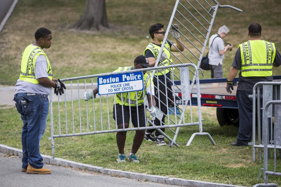 Workers set up barricades on Boston Common before the rally.