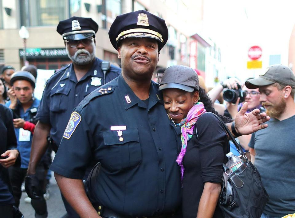 Boston Police Superintendent in Chief William Gross gave a hug to protester Tamika Rice at Downtown Crossing.