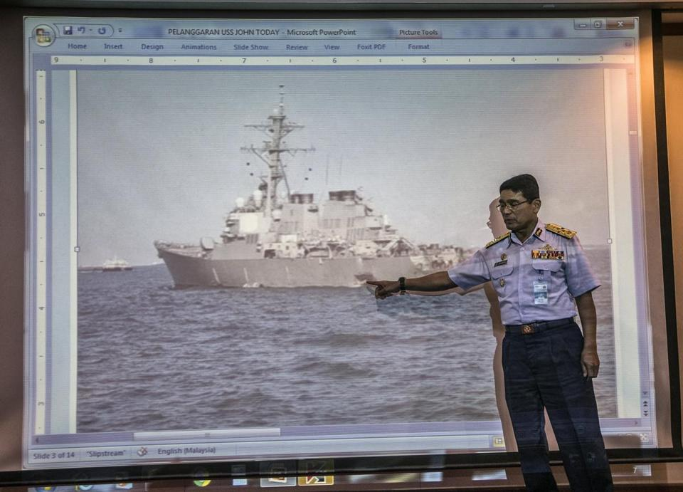 Malaysian Maritime Enforcement Agency (MMEA) Director General, Maritime Admiral Zulkifli Abu Bakar gestured at a screen projection of the damaged of the US guided-missile destroyer USS John S McCain.
