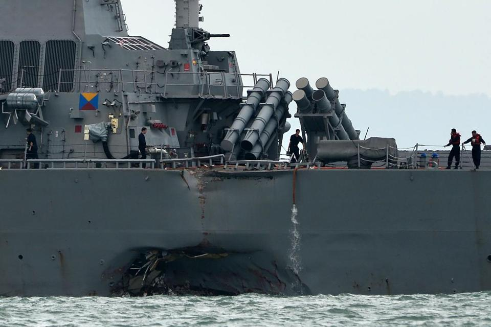 The guided-missile destroyer USS John S. McCain is seen with a hole on its portside after a collision with an oil tanker outside Changi naval base in Singapore on Monday.