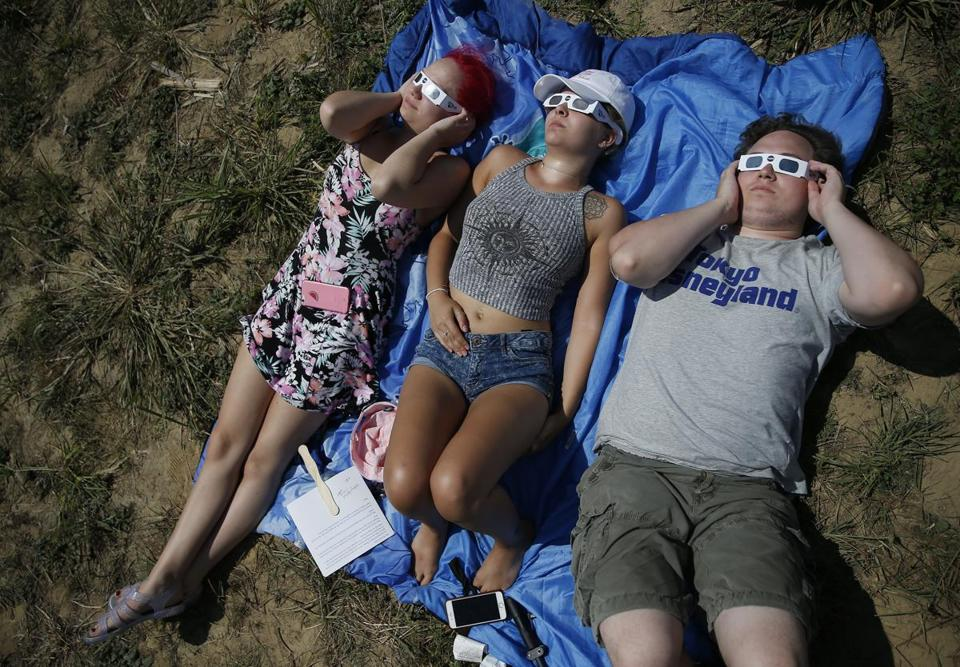 People used solar glasses to look at the sun during the eclipse.