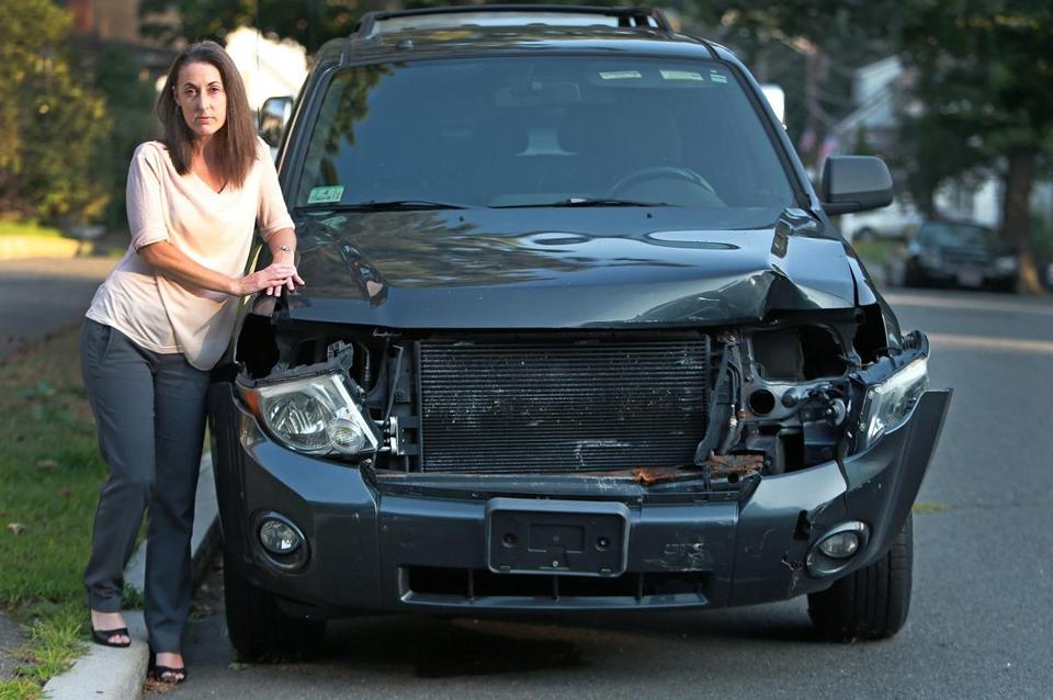Denise Roney says a driver of an MBTA SUV struck her car.
