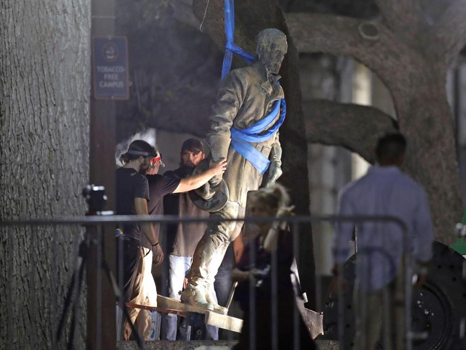 "A statue of Confederate Gen. Robert E. Lee is removed from the University of Texas campus, early Monday morning, Aug. 21, 2017, in Austin, Texas. University of Texas President Greg Fenves ordered the immediate removal of statues of Robert E. Lee and other prominent Confederate figures from a main area of campus, saying such monuments have become ""symbols of modern white supremacy and neo-Nazism."" (AP Photo/Eric Gay)"