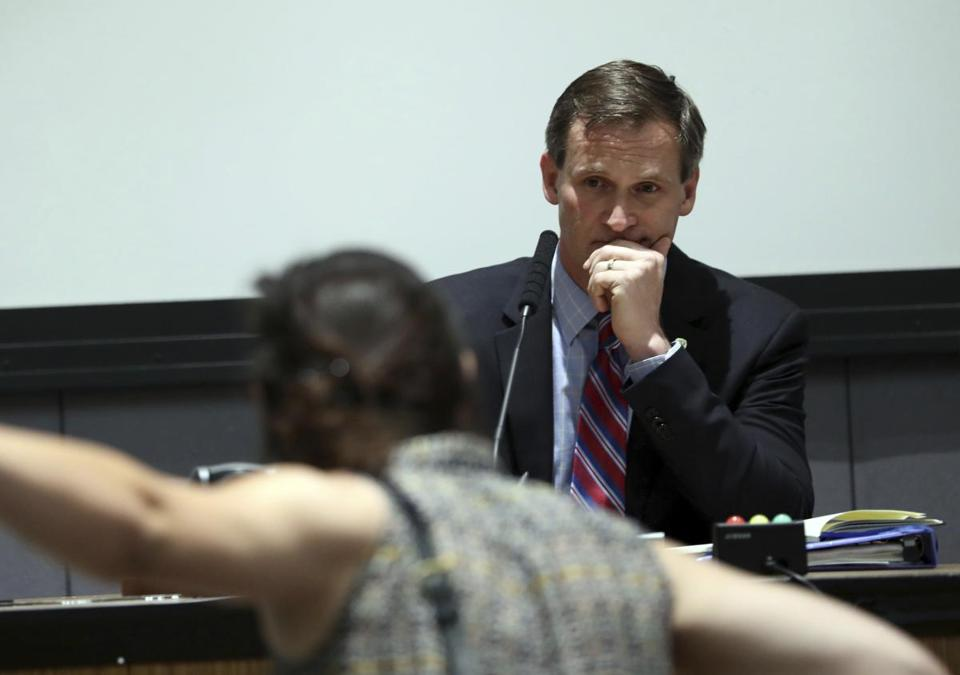 A protestor yelled at Charlottesville, Va., Mayor Mike Signer during Monday's meeting of the city council.