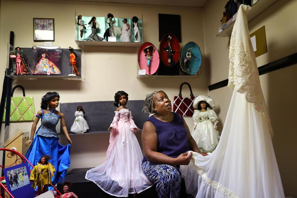 Mansfield-8/23/17 The National Black Doll Museum is in Mansfield with over 6,000 dolls of color. Founder Debra Britt gets emotional as she holds her wedding dress from 1977 which is in one of the displays of dresses. John Tlumacki/Globe Staff(south)
