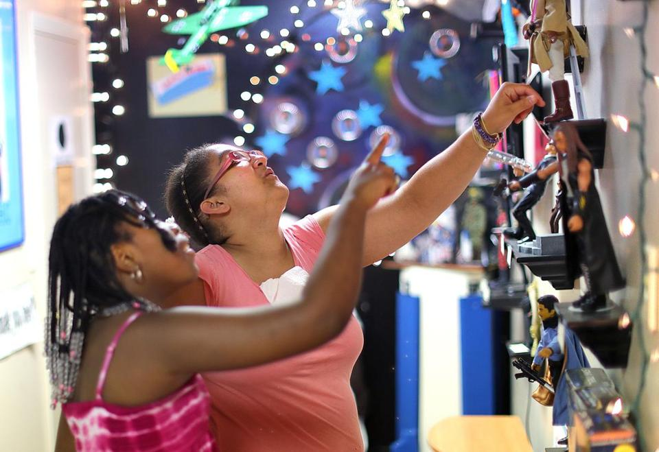 Mansfield-8/23/17 The National Black Doll Museum is in Mansfield with over 6,000 dolls of color. Chaundra Butler, 11, (left) and Jessica Gomes look at a doll display. John Tlumacki/Globe Staff(south)