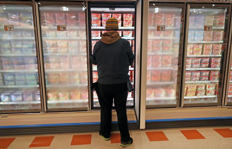 Alex Halstead worked on the ice cream display at the Lynn store.