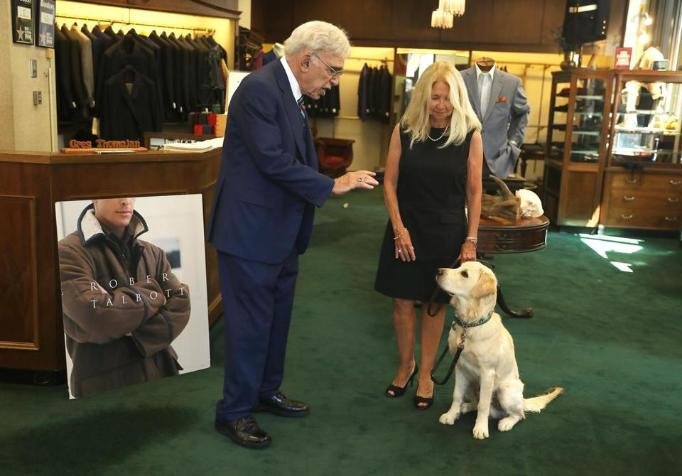 """This has always been a men's club,"" said Greg Thomajan's wife, Andrea, who is Zareh's bookkeeper — yet they function as a team. They met on the sales floor of the downtown Boston store in the 1970s. Skipper, 7 months old, is their golden retriever."