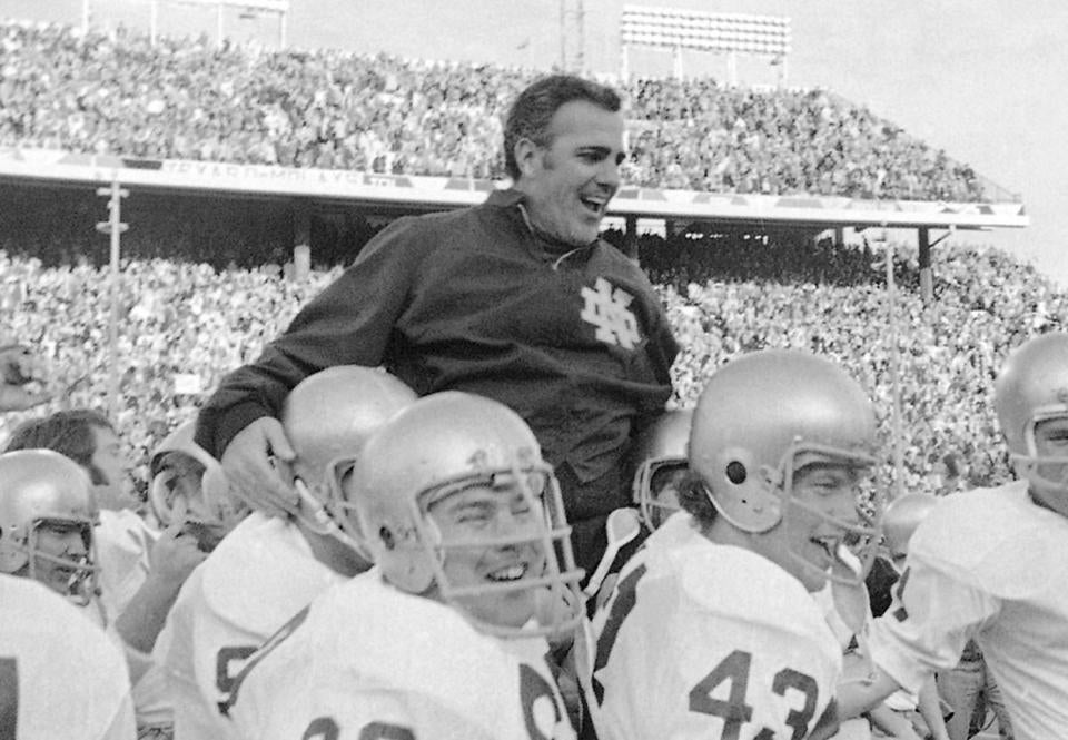 Ara Parseghian is carried off by his players after Notre Dame beat Texas in the 1971 Cotton Bowl.