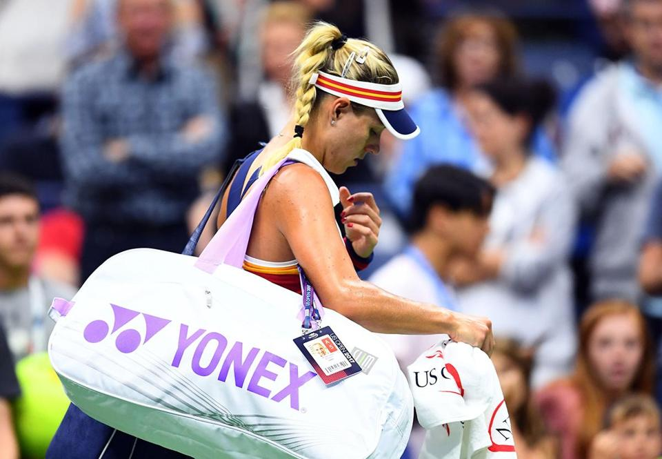 Germanys Angelique Kerber leaves the court after being defeated by Japans Naomi Osaka during their 2017 US Open Women's Singles match at the USTA Billie Jean King National Tennis Center in New York on August 29, 2107. / AFP PHOTO / Jewel SAMADJEWEL SAMAD/AFP/Getty Images