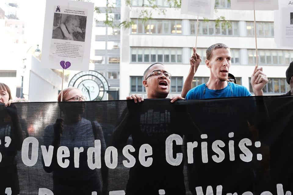 "NEW YORK, NY - AUGUST 17: Recovering drug users, activists and social service providers hold a morning rally calling for ""bolder political action"" in combating the overdose epidemic outside of the office of Governor Andrew Cuomo on August 17, 2017 in New York City. According to the latest data available from the National Institute on Drug Abuse, nearly 35,000 people across America died of heroin or opioid overdoses in 2015. (Photo by Spencer Platt/Getty Images)"