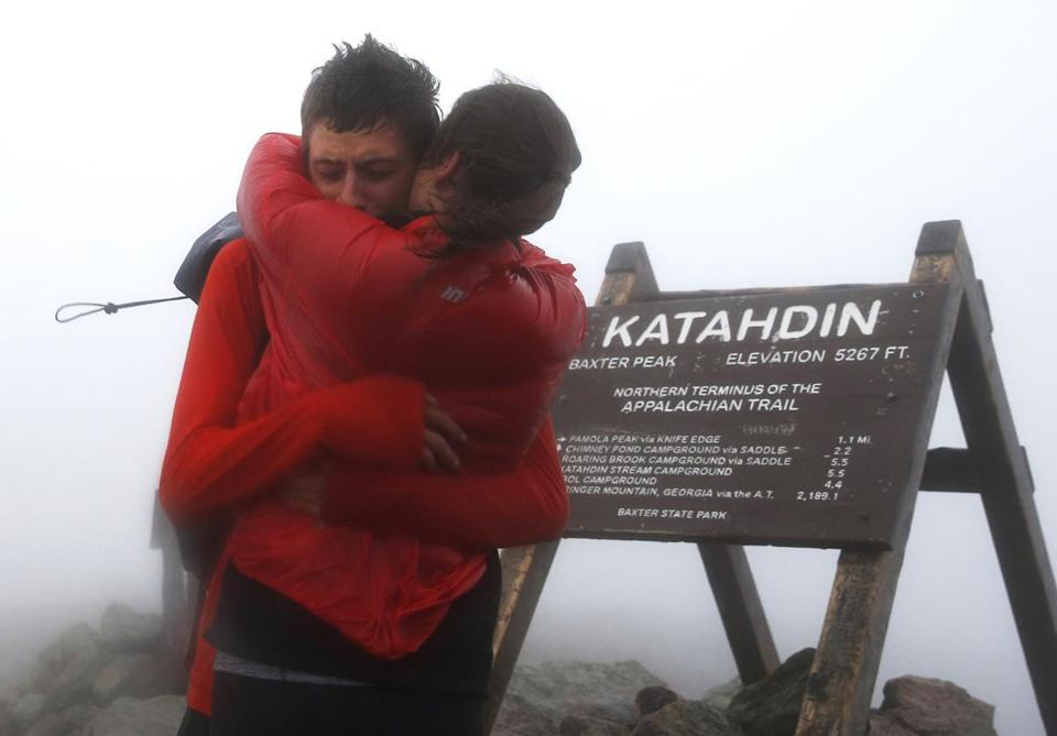 Joe McConaughy embraced his girlfriend, Katie Kiracofe, as he reached the summit of Mount Katahdin after breaking the record for fastest unsupported hike of the Appalachian Trail.