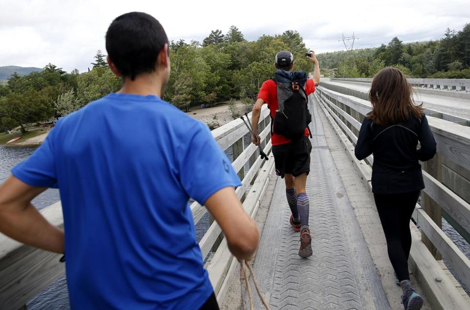 McConaughy held out his GoPro and filmed as he ran over Abol Bridge with his girlfriend, Katie Kiracofe (right), and friend Josh Katzman after he emerged from the wilderness.