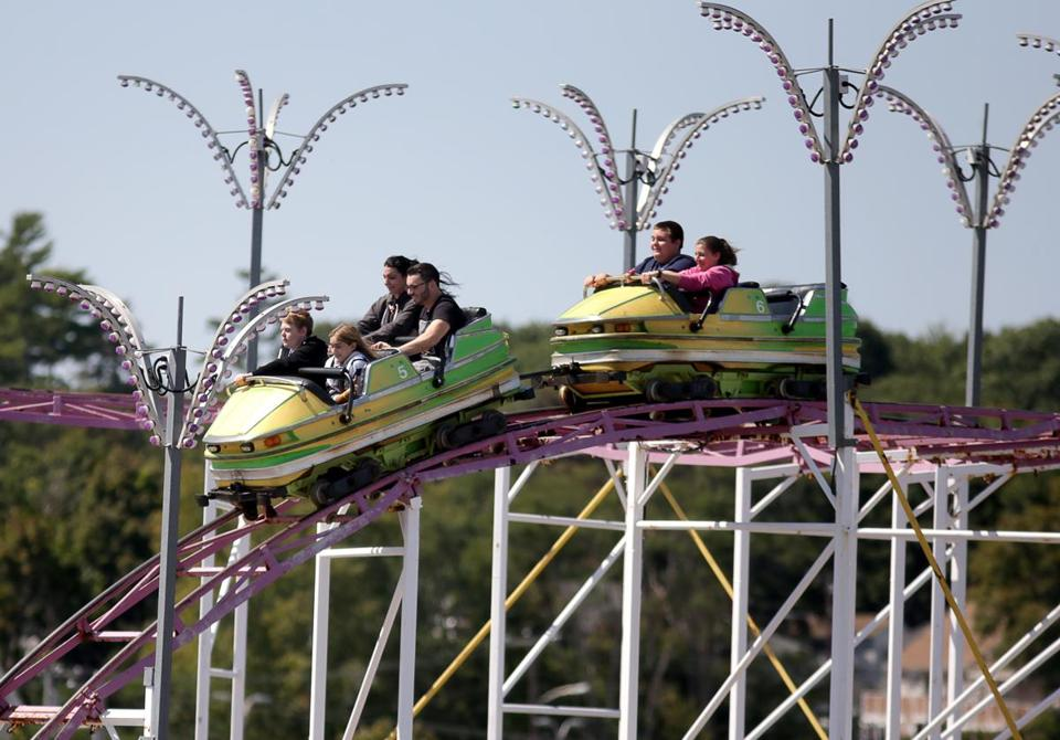 Passengers held on tight as the Galaxi coaster headed downhill.