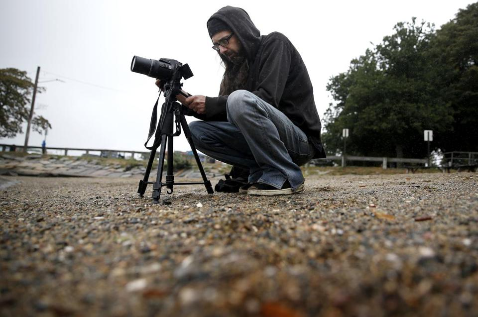 Jason Torres, of Mason, N.H., uses his camera to search for evidence of the Earth's curvature. He says he hasn't found any.