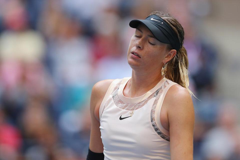 NEW YORK, NY - SEPTEMBER 03: Maria Sharapova of Russia reacts during her women's singles fourth round match against Anastasija Sevastova of Latvia on Day Seven of the 2017 US Open at the USTA Billie Jean King National Tennis Center on September 3, 2017 in the Flushing neighborhood of the Queens borough of New York City. (Photo by Richard Heathcote/Getty Images)