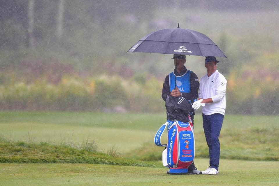 "Rickie Fowler had to endure some rain on the 18th hole as he finished a round of 66 on Sunday. ""It was a good, solid day,"" he said."