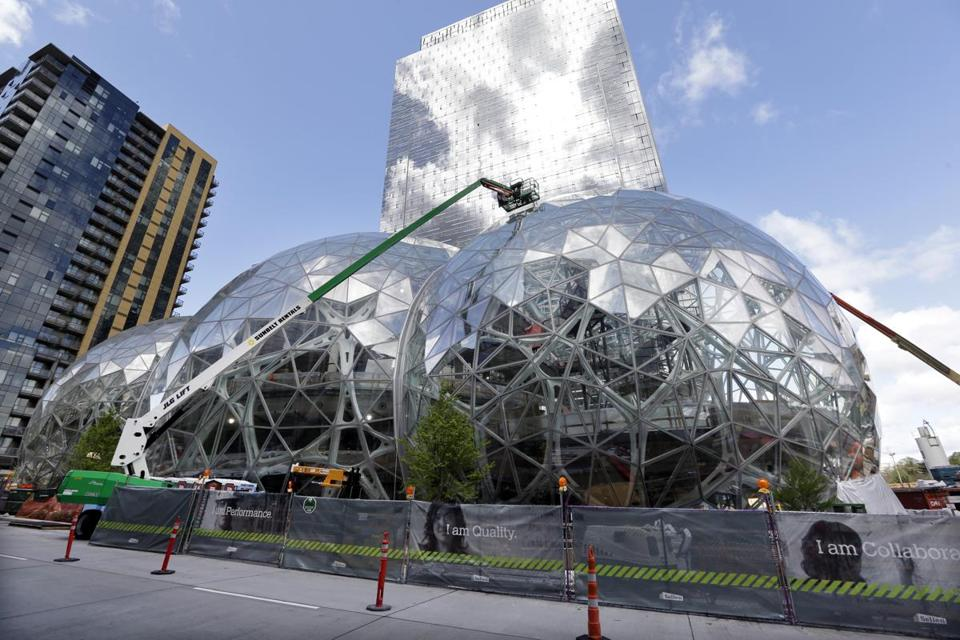 Construction continued on three large, glass-covered domes as part of an expansion of the Amazon.com campus in downtown Seattle.