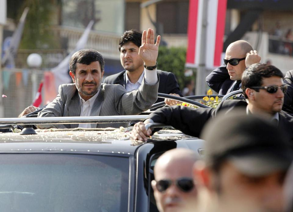BEIRUT, LEBANON - OCTOBER 13: Iranian President Mahmoud Ahmadinejad waves to the crowd in southern suberb of Beirut upon his arrival on October 13, 2010 in Lebanon. The controversial visit is seen as a boost for key ally Hezbollah. According to reports Mr Ahmadinejad may visit the border with Israel - the site of recent deadly clashes between Israeli and Lebanese forces. (Photo by Salah Malkawi/Getty Images)